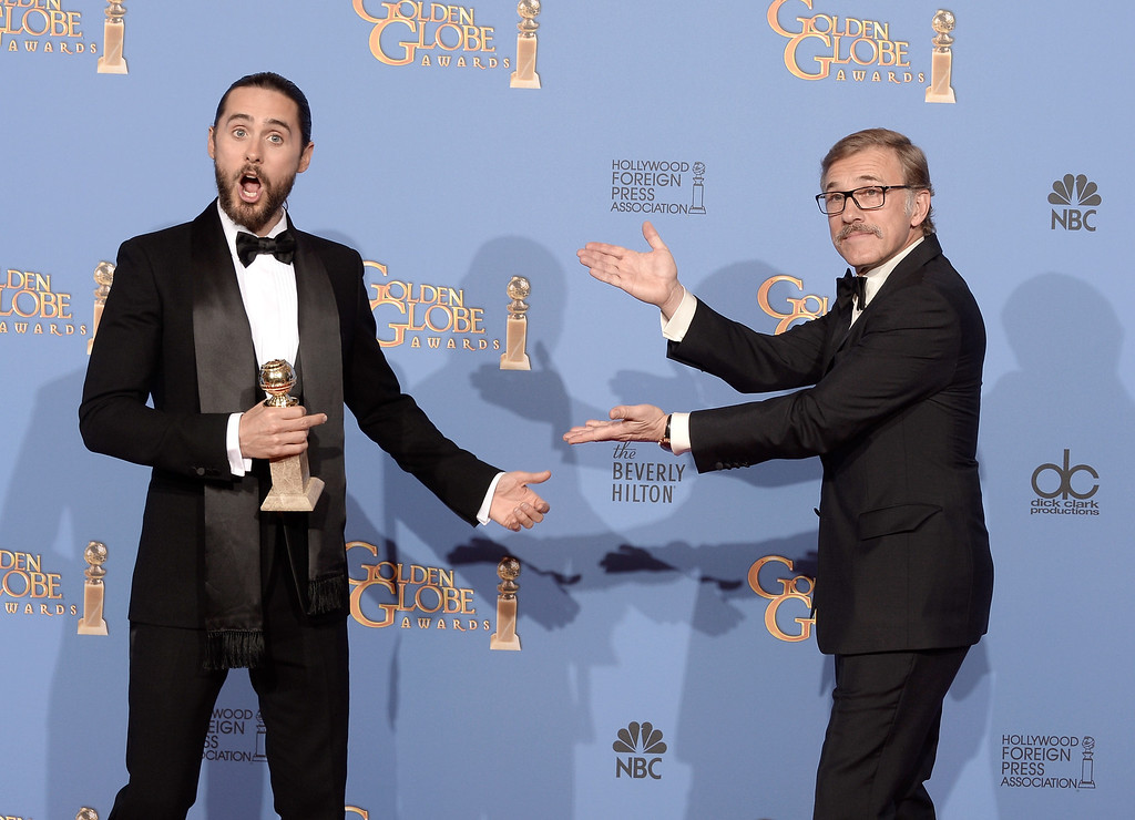 Description of . Actor Jared Leto (L), winner of Best Supporting Actor in a Motion Picture - Drama, Musical or Comedy for \'Dallas Buyers Club,\' and actor Christoph Waltz pose in the press room during the 71st Annual Golden Globe Awards held at The Beverly Hilton Hotel on January 12, 2014 in Beverly Hills, California.  (Photo by Kevin Winter/Getty Images)