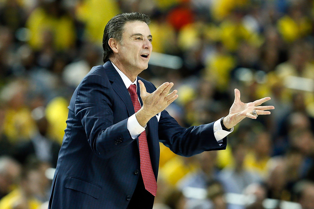 Description of . ATLANTA, GA - APRIL 06:  Head coach Rick Pitino of the Louisville Cardinals reacts in the first half against the Wichita State Shockers during the 2013 NCAA Men's Final Four Semifinal at the Georgia Dome on April 6, 2013 in Atlanta, Georgia.  (Photo by Kevin C. Cox/Getty Images)