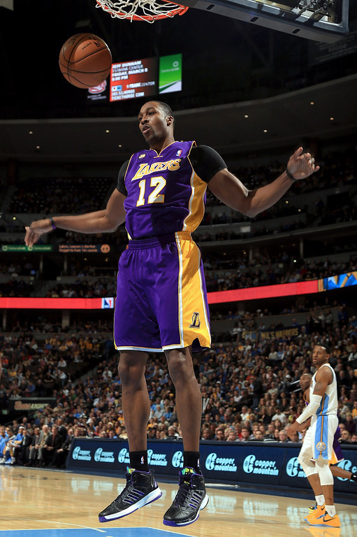 Description of . Dwight Howard #12 of the Los Angeles Lakers dunks the ball against the Denver Nuggets at the Pepsi Center on February 25, 2013 in Denver, Colorado. NOTE TO USER: User expressly acknowledges and agrees that, by downloading and or using this photograph, User is consenting to the terms and conditions of the Getty Images License Agreement.  (Photo by Doug Pensinger/Getty Images)
