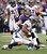 Denver Broncos wide receiver Demaryius Thomas (88) is brought down by Baltimore Ravens cornerback Cary Williams (29) after a short gain during the second quarter Sunday, December 16, 2012 at M&T Bank Stadium. John Leyba, The Denver Post