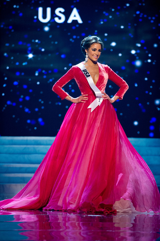 Description of . Miss USA 2012, Olivia Culpo, competes in an evening gown of her choice during the Evening Gown Competition of the 2012 Miss Universe Presentation Show on Thursday, Dec. 13, 2012 at PH Live in Las Vegas, Nevada. The 89 Miss Universe Contestants will compete for the Diamond Nexus Crown on December 19.  (AP Photo/Miss Universe Organization L.P., LLLP)