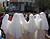 Nuns watch the newly elected Pope Francis on a giant screen blessing the faithful gathered at St. Peter's Square during his Sunday Angelus prayer, at the Plaza de Mayo square in Buenos Aires March 17, 2013. REUTERS/Enrique Marcarian