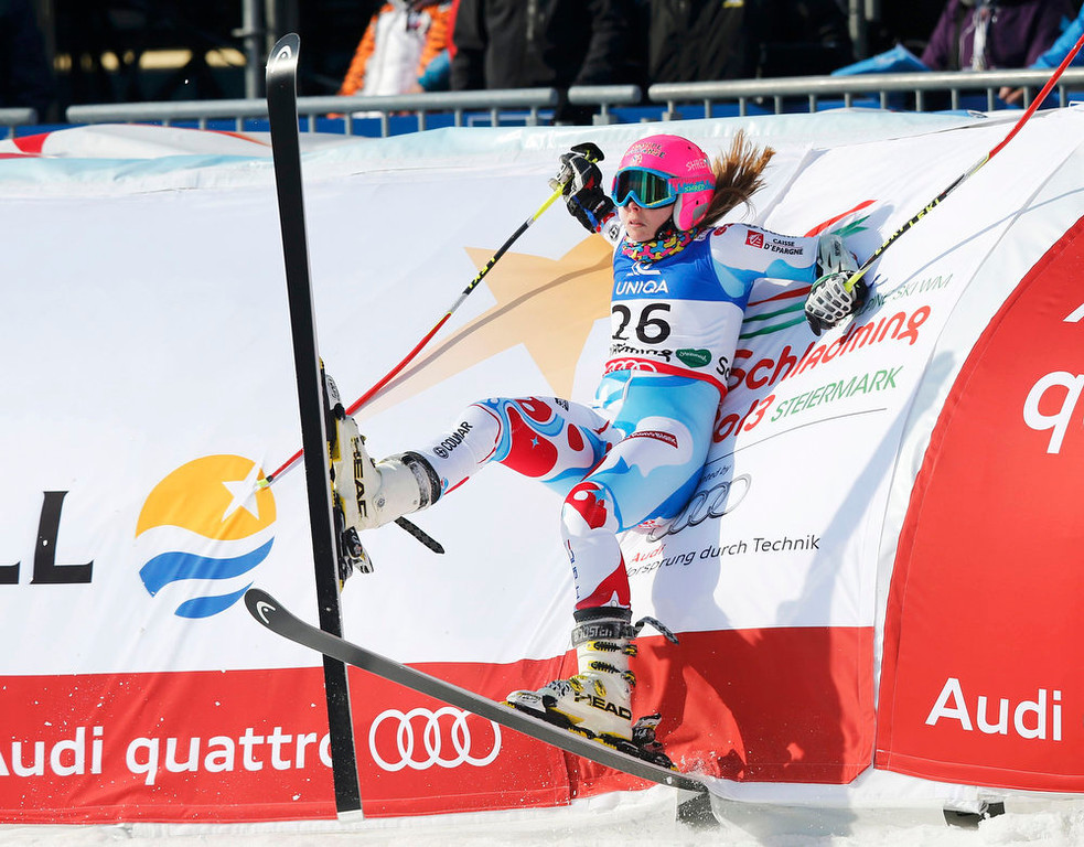 Description of . Anne-Sophie Barthet of France rests against the barrier after crossing the finish line in her second run of the women's Giant Slalom race at the World Alpine Skiing Championships in Schladming February 14, 2013. REUTERS/Leonhard Foeger