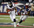 Houston Texans running back Arian Foster (23) is chased by New England Patriots middle linebacker Brandon Spikes during the first half of an AFC divisional playoff NFL football game in Foxborough, Mass., Sunday, Jan. 13, 2013. (AP Photo/Stephan Savoia)