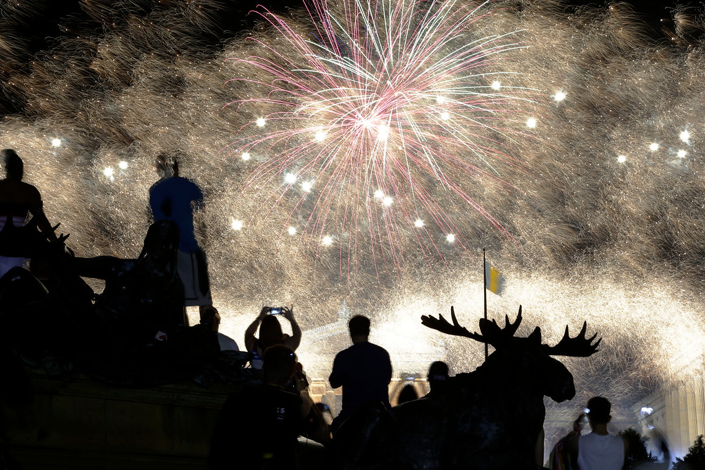 Description of . Fireworks explode over the Philadelphia Museum of Art during an Independence Day celebration, Thursday, July 4, 2013, in Philadelphia. (AP Photo/Matt Rourke)