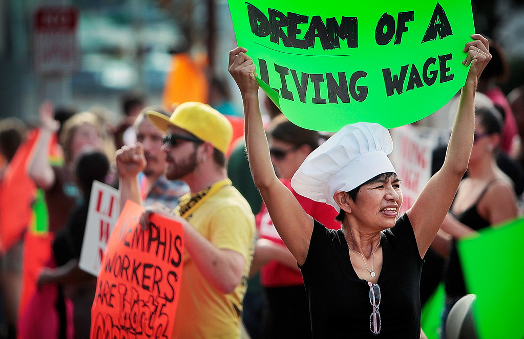 Description of . Christina Condori joins a crowd of low-income fast food workers and their supporters in protest on Thursday, Aug. 29, 2013, while picketing outside of the McDonalds restaurant in Memphis, Tenn. (AP Photo/The Commercial Appeal, Jim Weber)