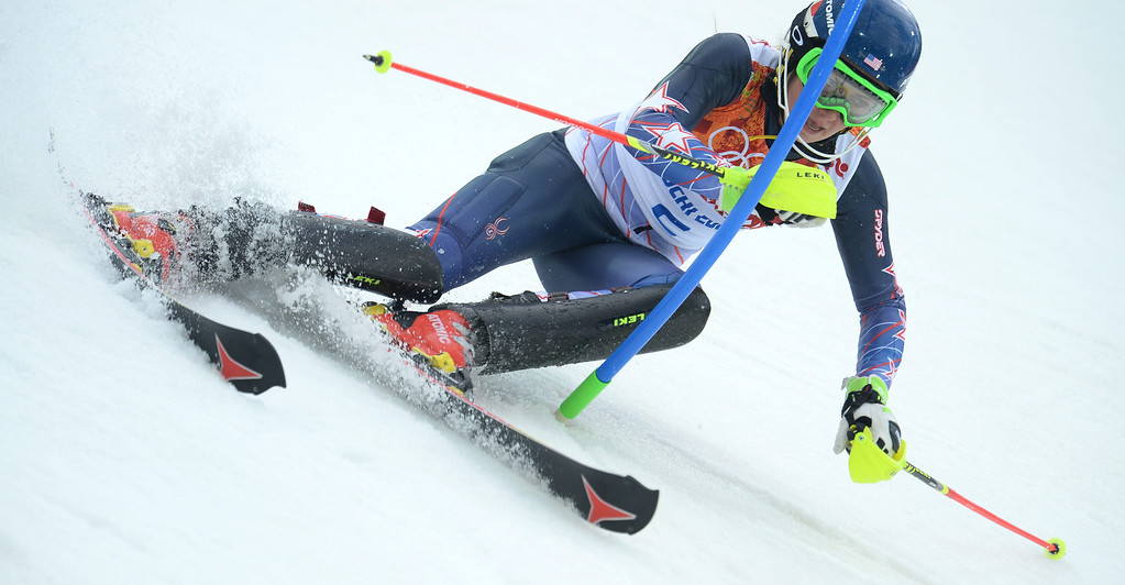 Description of . Mikaela Shiffrin of the US in action during the first run of the Women's Slalom race at the Rosa Khutor Alpine Center during the Sochi 2014 Olympic Games, Krasnaya Polyana, Russia, 21February 2014.  EPA/VASSIL DONEV