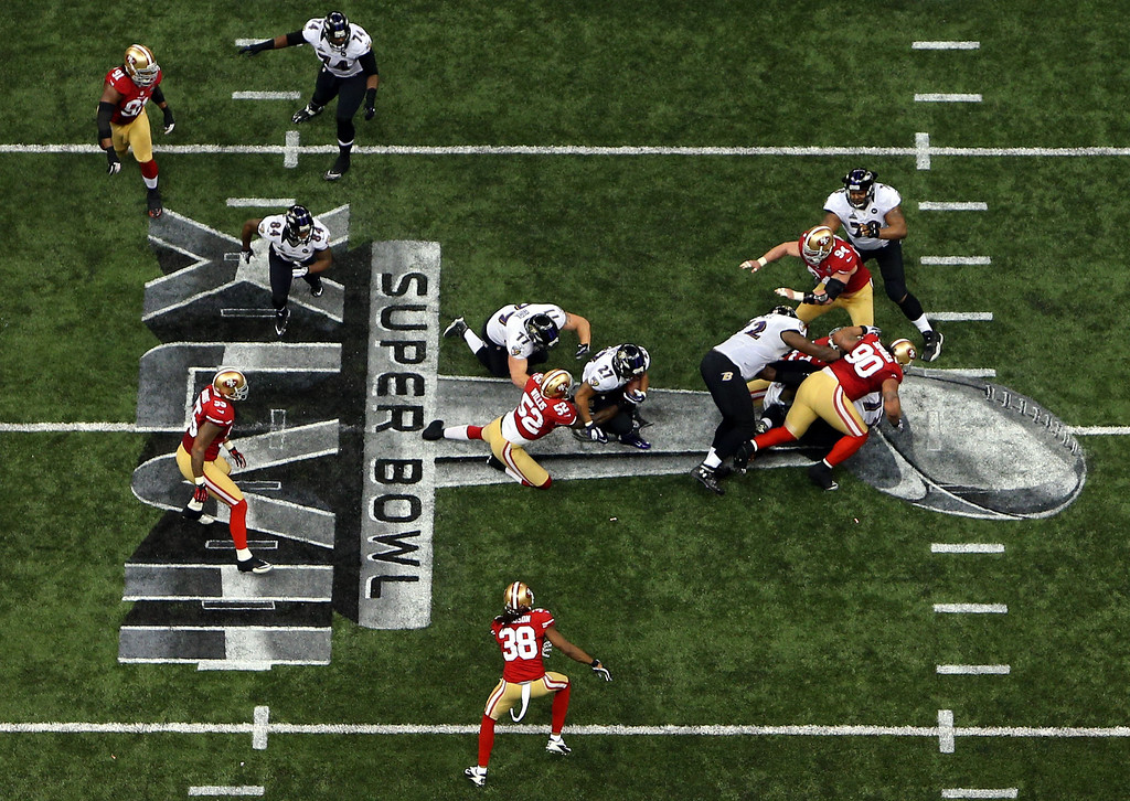 Description of . Ray Rice #27 of the Baltimore Ravens runs with the ball in the fist half against Patrick Willis #52 of the San Francisco 49ers during Super Bowl XLVII at the Mercedes-Benz Superdome on February 3, 2013 in New Orleans, Louisiana.  (Photo by Rob Carr/Getty Images)