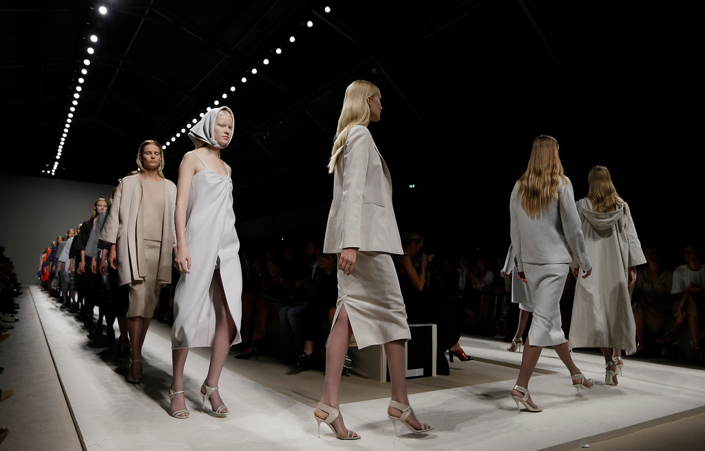 Description of . Models wear creations for Max Mara women's Spring-Summer 2014 collection, part of the Milan Fashion Week, unveiled in Milan, Italy, Thursday, Sept. 19, 2013. (AP Photo/Luca Bruno)