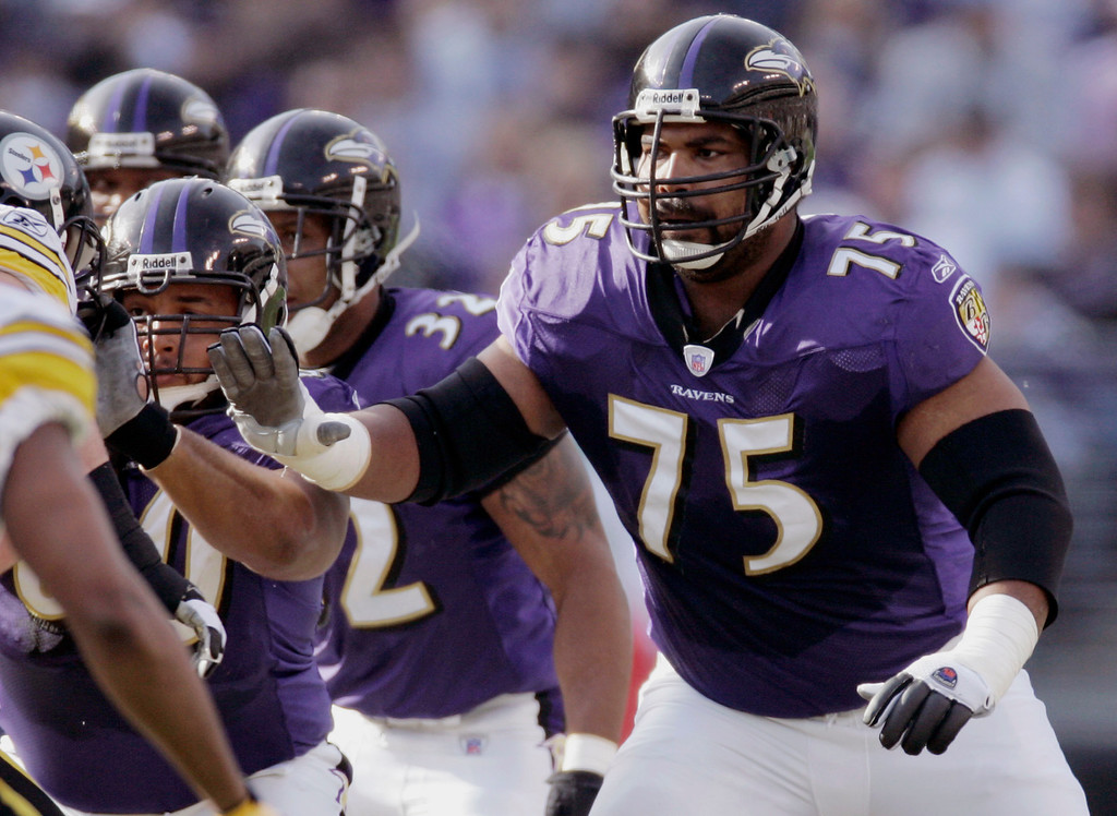 Description of . FILE - In this Nov. 26, 2006 file photo, Baltimore Ravens offensive lineman Jonathan Ogden blocks against the Pittsburgh Steelers during the first half of an NFL football game in Baltimore. Ogden was selected to the Pro Football Hall of Fame on Saturday, Feb. 2, 2013. (AP Photo/Chris Gardner, File)