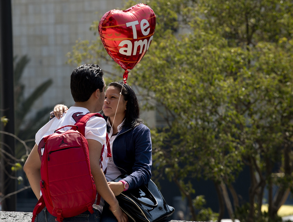 Description of . A couple looks each other in the eye on St Valentine's Day at the Republic Square in Mexico City on February 14, 2013.  AFP PHOTO/Yuri CORTEZ/AFP/Getty Images