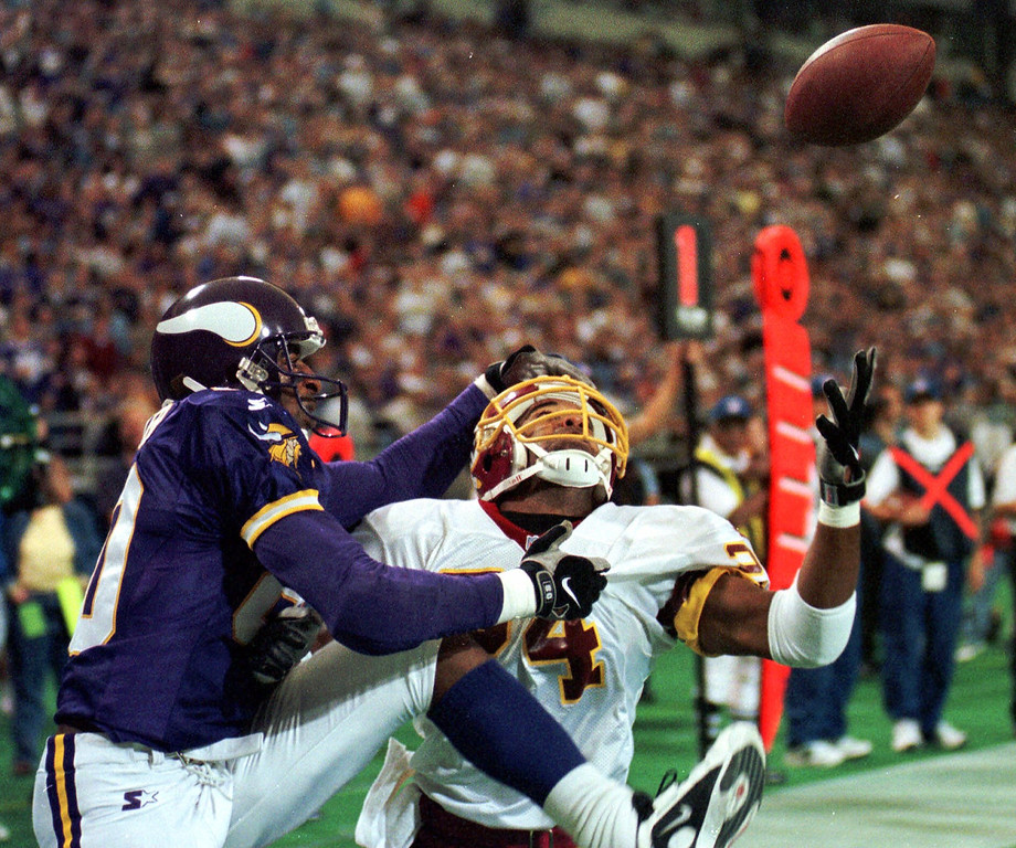 Description of . Washington Redskins defender Stanley Richard, right, breaks up a pass to Minnesota Vikings wide receiver Chris Carter (80) in the end zone during the first quarter Sunday, Oct. 18, 1998, in Minneapolis. (AP Photo/Tom Olmscheid)
