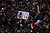 Protesters opposing Egyptian President Mohamed Mursi shout slogans and hit a poster of Mursi that reads 