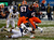 Jerome Smith #45 of the Syracuse Orange breaks away from Darwin Cook #25 of the West Virginia Mountaineers in the New Era Pinstripe Bowl at Yankee Stadium on December 29, 2012 in the Bronx borough of New York City.  (Photo by Jeff Zelevansky/Getty Images)