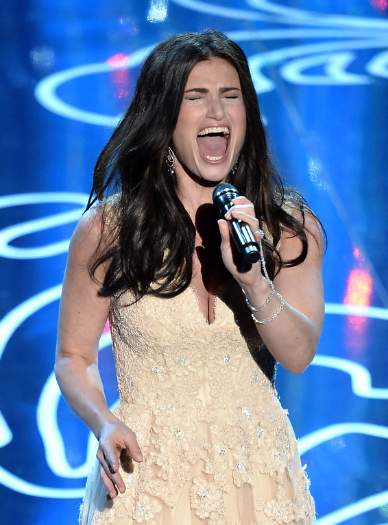 Description of . Actress/singer Idina Menzel performs onstage during the Oscars at the Dolby Theatre on March 2, 2014 in Hollywood, California.  (Photo by Kevin Winter/Getty Images)