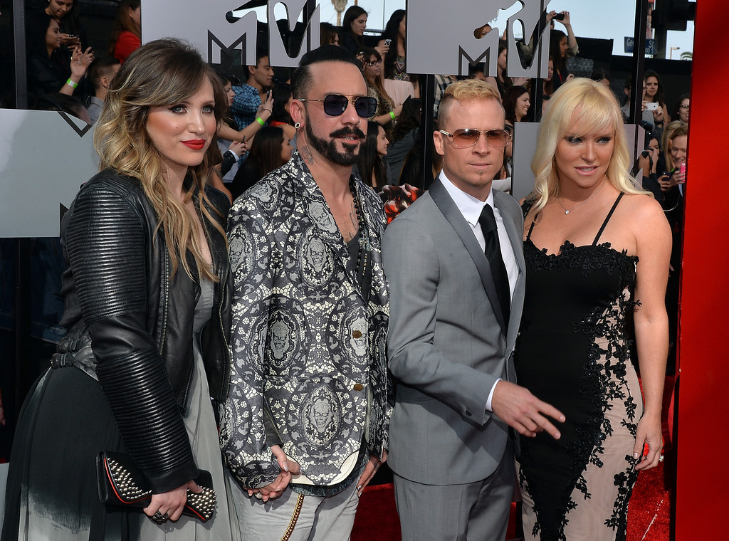 Description of . (L-R) Rochelle Deanna Karidis, singers AJ McLean and Brian Littrell of Backstreet Boys, and Leighanne Littrell attend the 2014 MTV Movie Awards at Nokia Theatre L.A. Live on April 13, 2014 in Los Angeles, California.  (Photo by Michael Buckner/Getty Images)