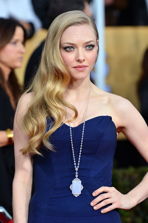 . Actress Amanda Seyfried arrives at the 19th Annual Screen Actors Guild Awards held at The Shrine Auditorium on January 27, 2013 in Los Angeles, California.  (Photo by Frazer Harrison/Getty Images)