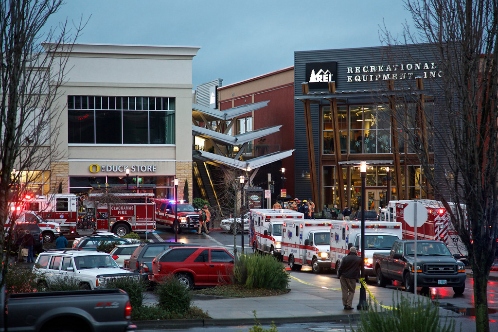 Description of . Emergency personnel stage an area outside the Clackamas Town Center in Portland, Ore., where a shooting occurred, Tuesday, Dec. 11, 2012. Witnesses say the scene went from cheery to chaotic in seconds when a gunman opened fire in the suburban Portland shopping mall Tuesday, killing two people and wounding another. (AP Photo/The Oregonian, Thomas Boyd)