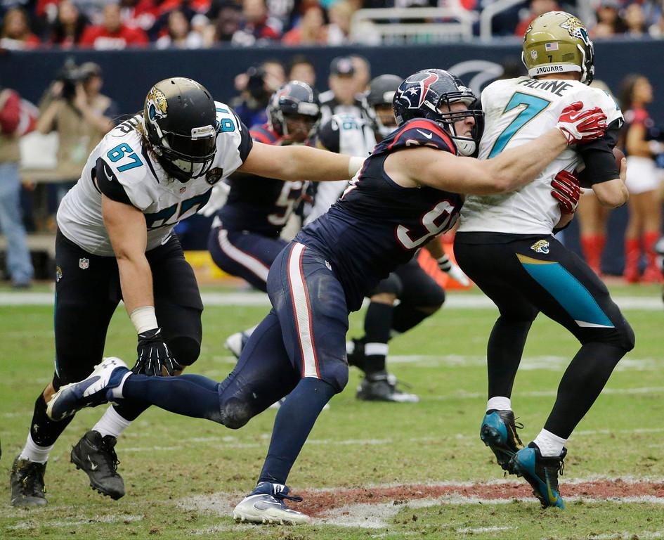 Description of . Houston Texans defensive end J.J. Watt (99) sacks Jacksonville Jaguars quarterback Chad Henne (7) during the second quarter of an NFL football game Sunday, Nov. 24, 2013, in Houston. (AP Photo/David J. Phillip)