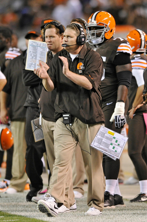 Description of . Cleveland Browns coach Rob Chudzinski cheers from the sidelines in the second quarter of an NFL football game against the Buffalo Bills on Thursday, Oct. 3, 2013, in Cleveland. (AP Photo/David Richard)