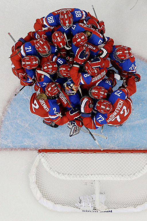 Description of . Team Russia celebrates their 2-1 win over Japan during the 2014 Winter Olympics women\'s ice hockey game at Shayba Arena, Tuesday, Feb. 11, 2014, in Sochi, Russia. (AP Photo/Mark Humphrey)