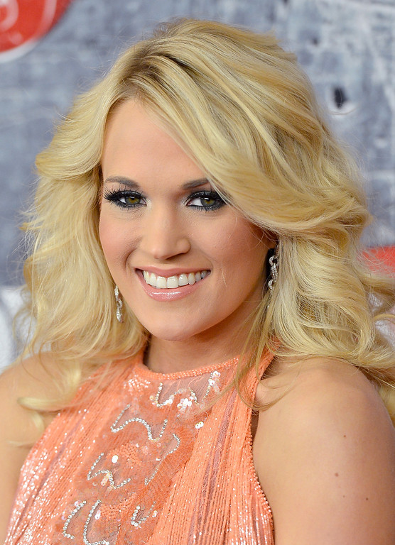 Description of . LAS VEGAS, NV - DECEMBER 10:  Singer Carrie Underwood arrives at the 2012 American Country Awards at the Mandalay Bay Events Center on December 10, 2012 in Las Vegas, Nevada.  (Photo by Frazer Harrison/Getty Images)