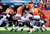 Denver Broncos running back Lance Ball #35 breaks away from a tackle by Tampa Bay Buccaneers defensive end Da'Quan Bowers #91 during the second quarter, The Denver Broncos vs The Tampa Bay Buccaneers at Sports Authority Field Sunday December 2, 2012. Tim Rasmussen, The Denver Post