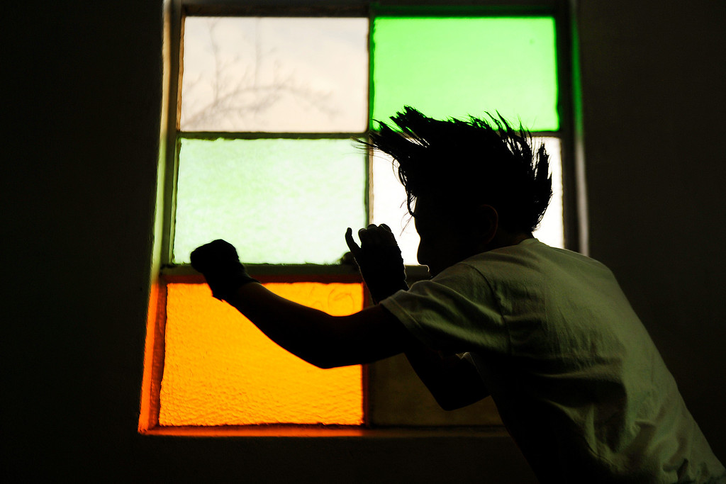 Description of . Jaydon Vigil, 12, shadow boxes in front of a window during an afternoon training session at the Denver Police Brotherhood Boxing gym on Wednesday, February 8, 2012. AAron Ontiveroz, The Denver Post