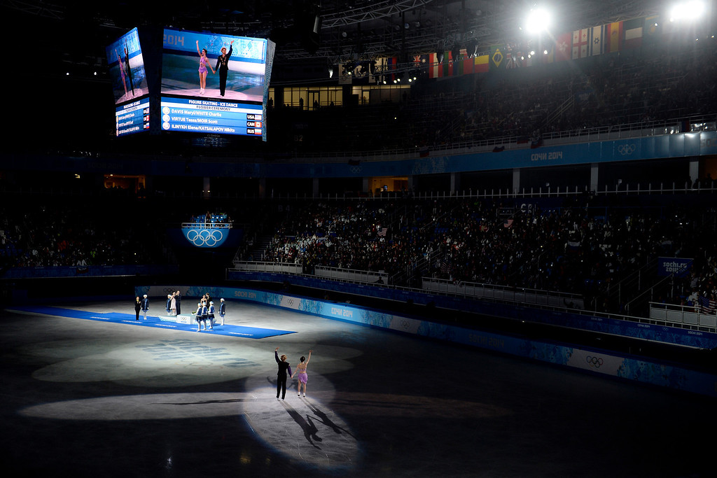 Description of . Gold medalists Charlie White and Meryl Davis of the U.S.A. wave to the crowd as they skate onto the ice to take the podium after the figure skating ice dancing free dance. Sochi 2014 Winter Olympics on Monday, February 17, 2014. (Photo by AAron Ontiveroz/The Denver Post)