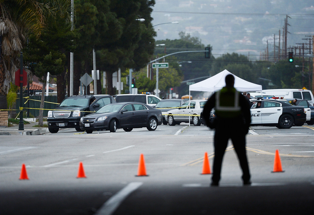 . Orange County Sheriff deputies investigate a crime scenes on February 19, 2013 in Tustin, California.  (Photo by Kevork Djansezian/Getty Images)