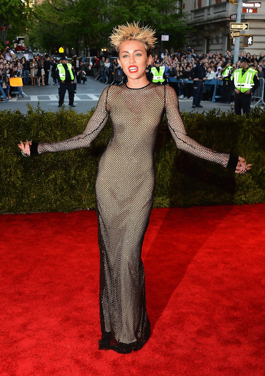 Description of . Miley Cyrus attends the Costume Institute Gala for the