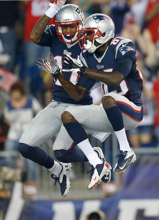 Description of . New England Patriots wide receiver Aaron Dobson (17) celebrates his touchdown against the New York Jets with wide receiver Kenbrell Thompkins, right, in the first quarter an NFL football game Thursday, Sept. 12, 2013, in Foxborough, Mass. (AP Photo/Elise Amendola)