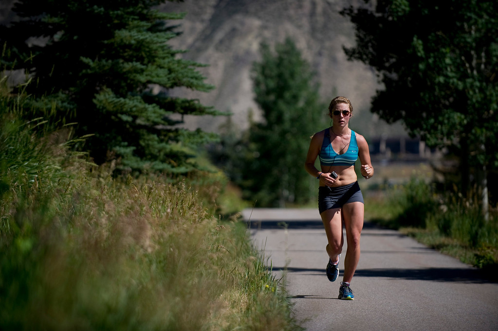 Description of . Olympic downhill skier Mikaela Shiffrin runs a four-mile uphill run as part of her training for this year's Winter Olympics, in Beaver Creek Co. on July 15, 2013. (Photo By Grant Hindsley/The Denver Post)