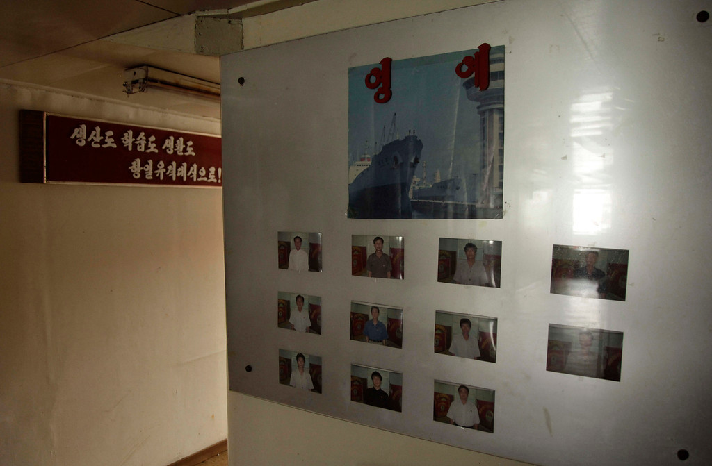 Description of . Snapshots of crew members are displayed on wall aboard a North Korean-flagged ship at the Manzanillo International container terminal on the coast of Colon City, Panama, Tuesday, July 16, 2013. (AP Photo/Arnulfo Franco)