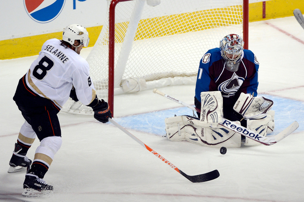 Description of . DENVER, CO. - FEBRUARY 06: Semyon Varlamov (1) of the Colorado Avalanche makes a save on a shot by Teemu Selanne (8) of the Anaheim Ducks during the second period February 6, 2013 at Pepsi Center. The Colorado Avalanche take on the Anaheim Ducks during NHL action. (Photo By John Leyba / The Denver Post)