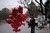 A Pakistani man stands on a roadside waiting for customers to sell heart-shaped balloons on Valentine's Day, in Islamabad, Pakistan, Thursday, Feb. 14, 2013. Romance may not be dead in Pakistan but it is under attack. Conservatives in Pakistan are attacking the romantic holiday as a western-inspired event helping to spread vulgarity in their country and putting up posters calling on people to boycott the holiday. But romantics are fighting back with an arsenal of flowers, pink teddy bears and heart-shaped balloons. (AP Photo/Muhammed Muheisen)