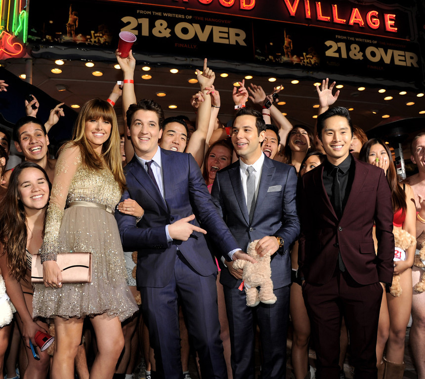 ". Actors Sarah Wright, Miles Teller, Skylar Astin and Justin Chon pose at the premiere of Relativity Media\'s ""21 And Over\"" at the Village Theatre on February 21, 2013 in Los Angeles, California.  (Photo by Kevin Winter/Getty Images)"