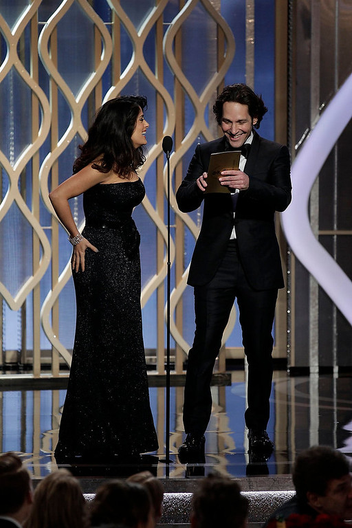 Description of . Presenters Salma Hayek (L) and Paul Rudd on stage at the 70th annual Golden Globe Awards in Beverly Hills, California January 13, 2013, in this picture provided by NBC. REUTERS/Paul Drinkwater/NBC/Handout
