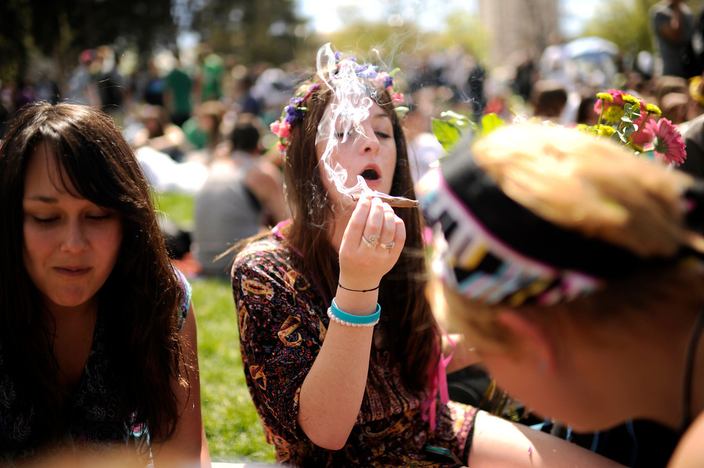 Description of . Malia Knapp of Denver, center, is celebrating Denver 420 Rally with her friends at Civic Center Park in Denver, Colo., on Friday, April 20, 2012. Hyoung Chang, The Denver Post