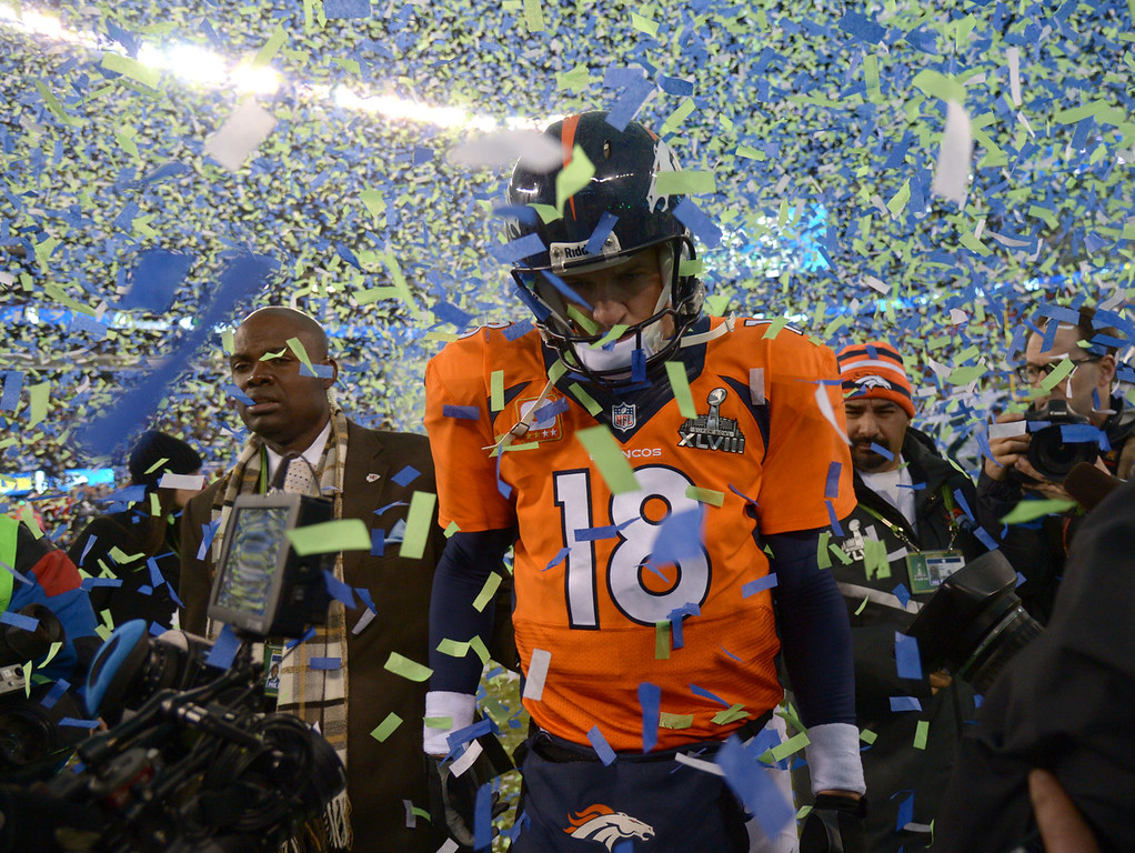 Description of . Denver Broncos quarterback Peyton Manning (18) walks on the field after the Seattle Seahawks beat the Denver Broncos 43-8 in Super Bowl 48. The Denver Broncos vs the Seattle Seahawks in Super Bowl XLVIII at MetLife Stadium in East Rutherford, New Jersey Sunday, February 2, 2014. (Photo by John Leyba/The Denver Post)