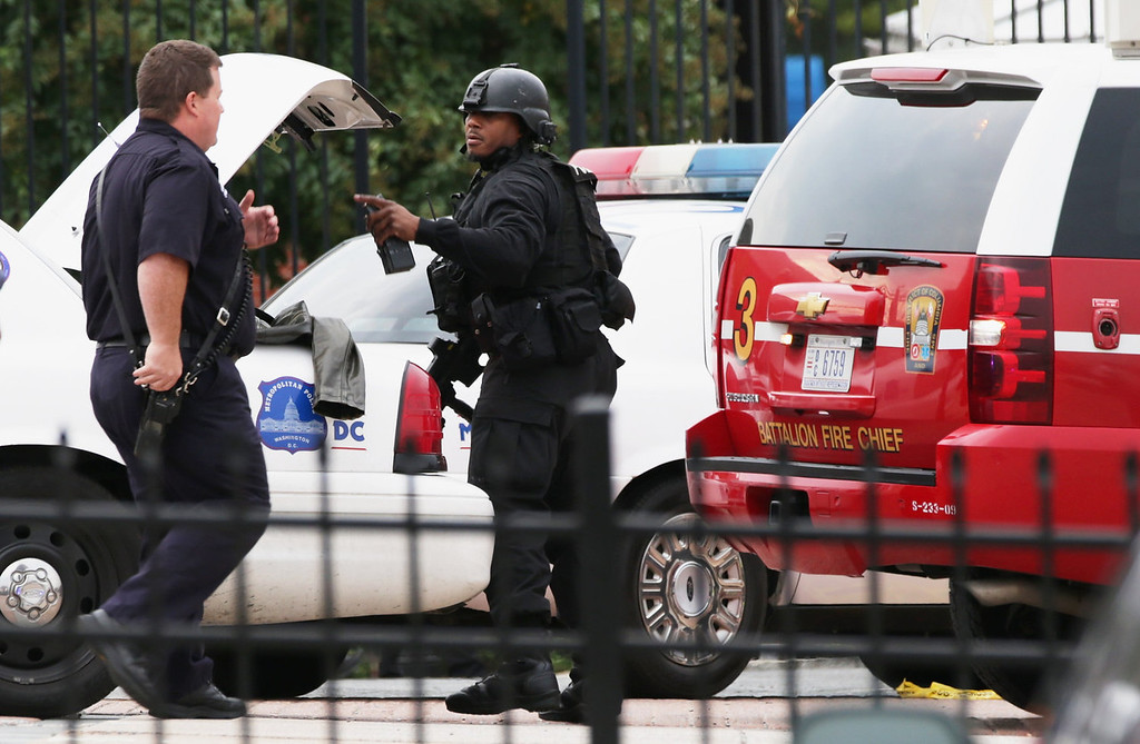 . Two DC Metro Police officers respond to a reported shooting at an entrance to the Washington Navy Yard September 16, 2013 in Washington, DC. According to the latest news report several people were shot with the shooter still possibly active.   (Photo by Alex Wong/Getty Images)