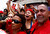 Supporters of deceased Venezuelan leader Hugo Chavez react as his coffin is driven through the streets of Caracas, March 6, 2013. Venezuela's late President Chavez died on Tuesday of cancer, and authorities have not yet said where he will be buried after his state funeral on Friday. REUTERS/Carlos Garcia Rawlins