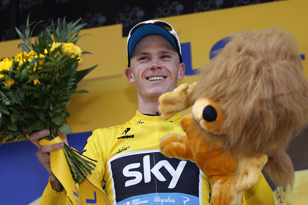 Description of . Britain's Christopher Froome celebrates his overall leader's yellow jersey on the podium at the end of the 195 km eighth stage of the 100th edition of the Tour de France cycling race on July 6, 2013 between Castres and Ax 3 Domaines, southwestern France.  PASCAL GUYOT/AFP/Getty Images