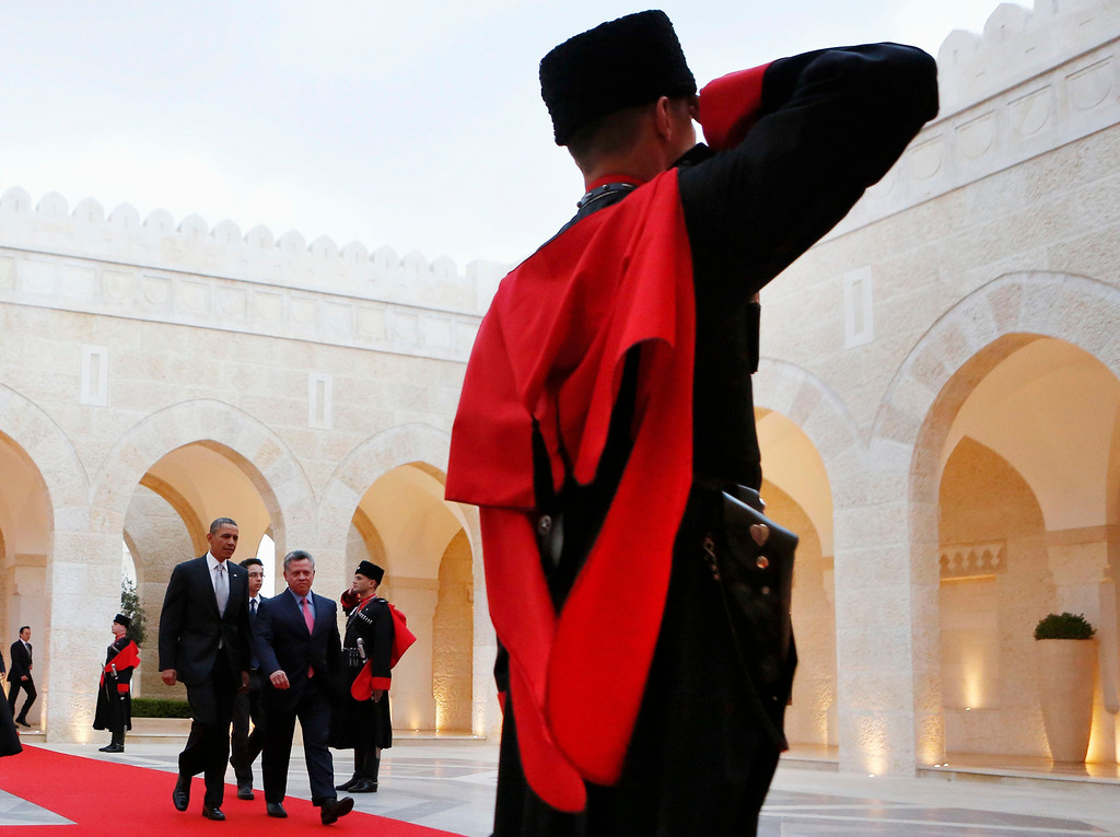 Description of . U.S. President Barack Obama is escorted by Amman by Jordan's King Abdullah II towards a private meeting at Al Hummar Palace in Amman, Jordan, March 22, 2013.  REUTERS/Larry Downing