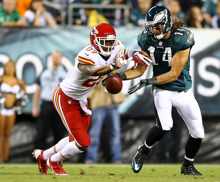 Description of . Sean Smith #27 of the Kansas City Chiefs breaks up a pass to  Riley Cooper #14 of the Philadelphia Eagles in the second quarter at Lincoln Financial Field on September 19, 2013 in Philadelphia, Pennsylvania.  (Photo by Elsa/Getty Images)
