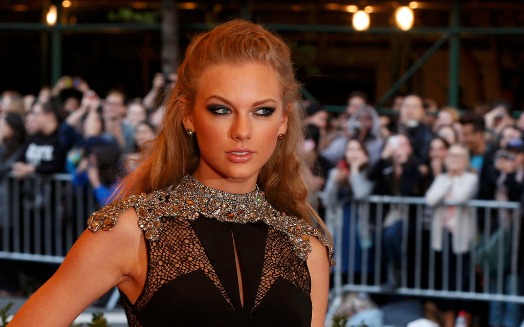 Description of . Singer Taylor Swift arrives at the Metropolitan Museum of Art Costume Institute Benefit celebrating the opening of