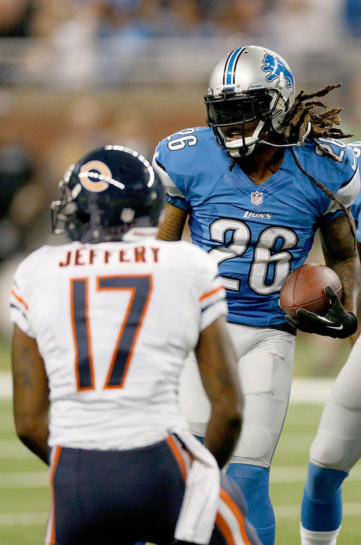 Description of . DETROIT, MI - SEPTEMBER 29:  Louis Delmas #26 of the Detroit Lions celebrates his first-quarter interception in front of Alshon Jeffery #17 of the Chicago Bears at Ford Field on September 29, 2013 in Detroit, Michigan. (Photo by Gregory Shamus/Getty Images)