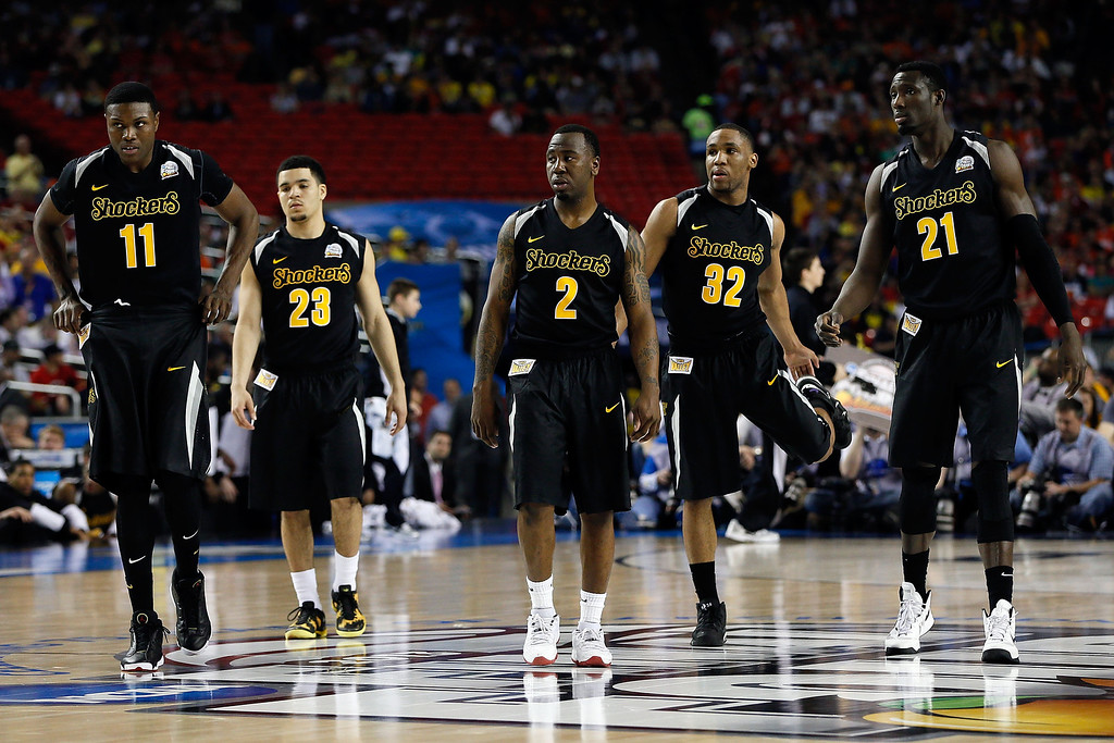 Description of . ATLANTA, GA - APRIL 06:  (L-R) Cleanthony Early #11, Fred VanVleet #23, Malcolm Armstead #2, Tekele Cotton #32 and Ehimen Orukpe #21 of the Wichita State Shockers look on in the second half against the Louisville Cardinals during the 2013 NCAA Men's Final Four Semifinal at the Georgia Dome on April 6, 2013 in Atlanta, Georgia.  (Photo by Kevin C. Cox/Getty Images)