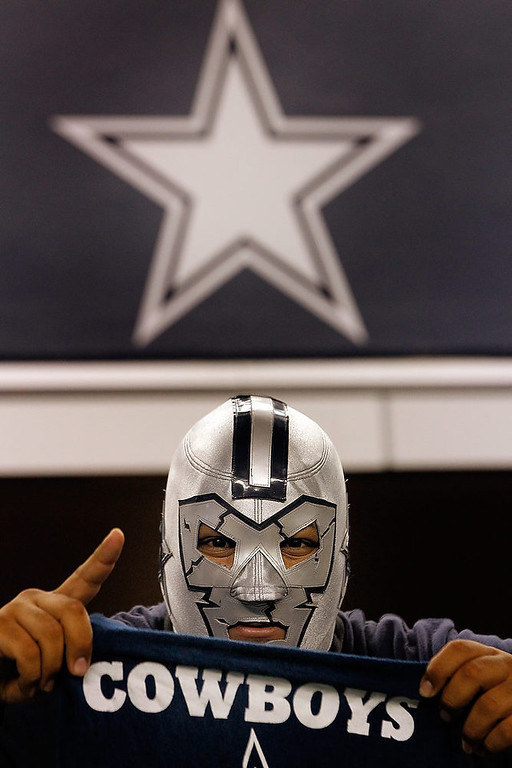 . A Dallas Cowboys fan cheers on his team while wearing a wrestling mask as the Dallas Cowboys take on the Philadelphia Eagles at Cowboys Stadium on December 2, 2012 in Arlington, Texas.  (Photo by Tom Pennington/Getty Images)