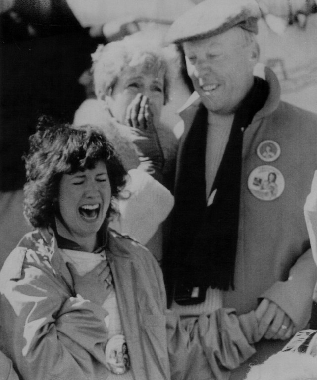 Description of . Betsy Corrigan, sister of Christa McAuliffe, reacts as she watches the Space Shuttle Challenger explode at the Kennedy Space Center in Florida, Tuesday, Jan. 28th, 1986. Behind Corrigan are Christa's parents Grace Corrigan (right) and father Ed. Denver Post Library Archive